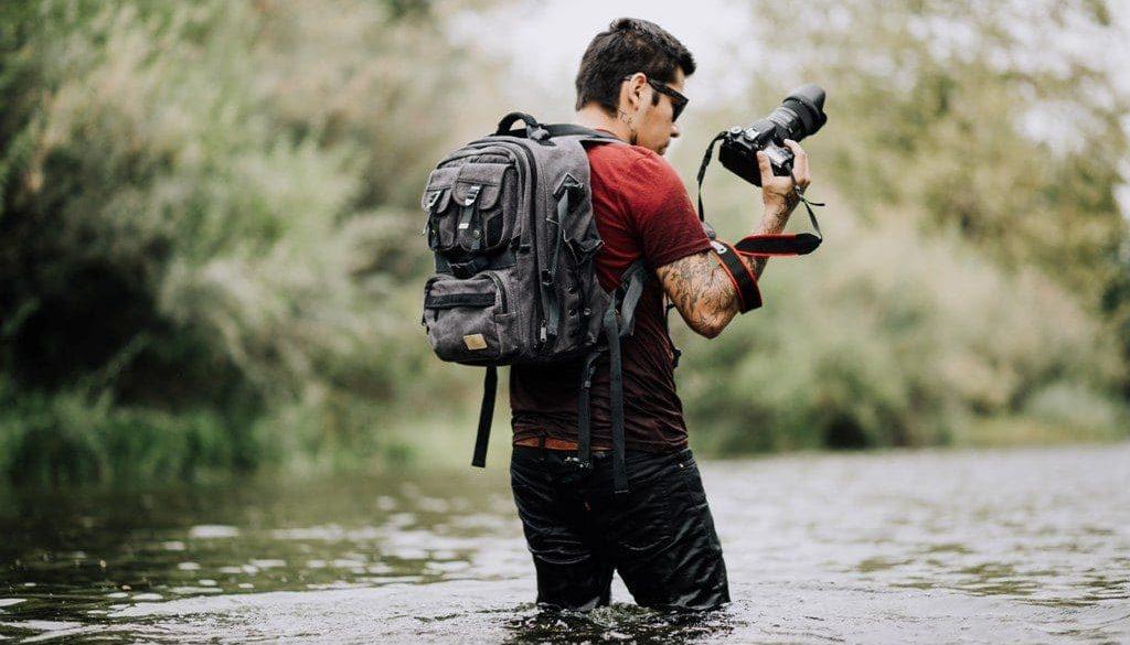 5k-guy-man-photographer-wading-wallpaper