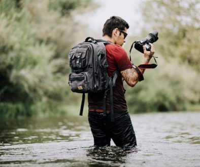 5k-guy-man-photographer-wading-wallpaper